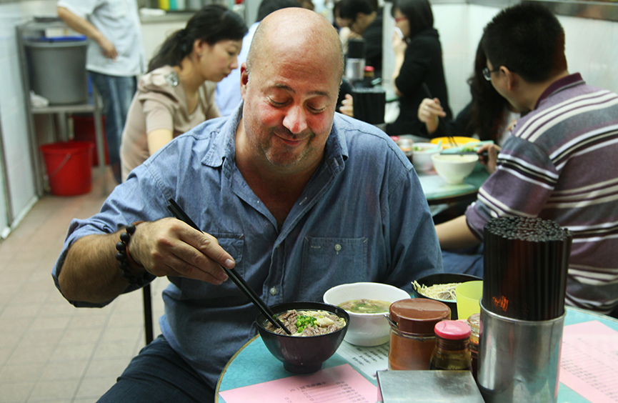 Tourist enjoys Kau Kee beef brisket noodle