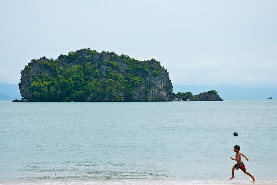 Boy running on Tanjung Rhu top islands in malaysia best islands in malaysia malaysia beach holiday destinations