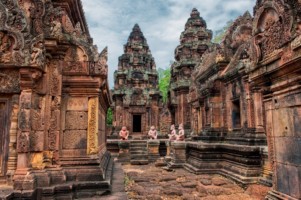 Banteay Srei is built largely of a hard red sandstone that can be carved like wood.