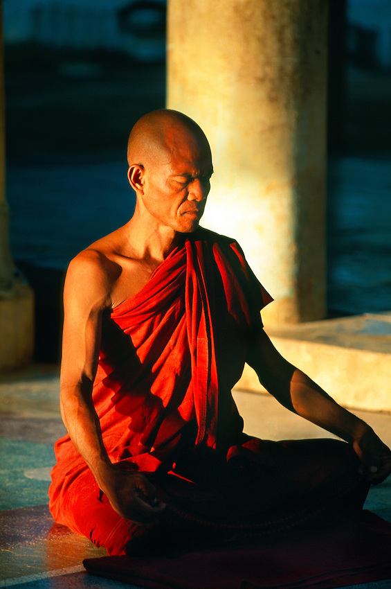 Buddhist monk meditating at Shwezigon Pagoda, Bagan (Pagan), Myanmar (Burma).