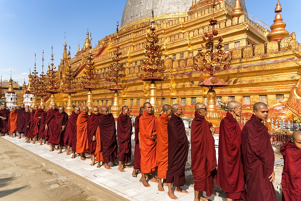 Monks at the Shwezigon Pagoda, Bagan (Pagan), Myanmar (Burma).