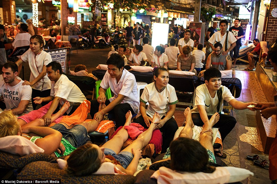 where to go for massage in bangkok People enjoy a leg massage on the streets as they are photographed by an intrepid photographer