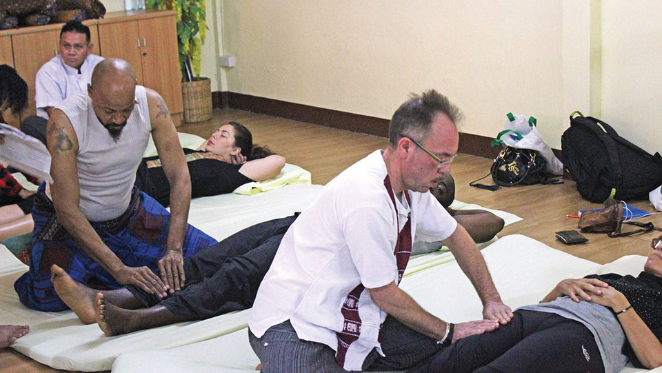 Students at the Wat Po Thai Traditional Massage School in Bangkok