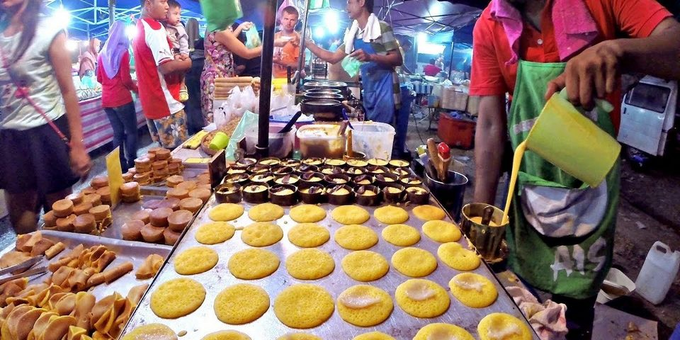 Delicious street food on night market stall Kuala Lumpur Malaysia royalty-free stock photo