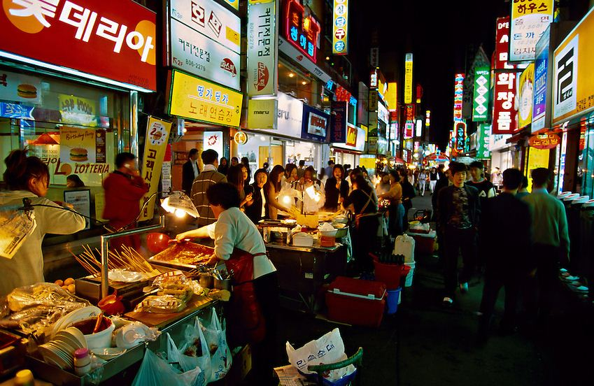 Koreans eating at street food stalls in the Sonmyon district of Pusan (Busan