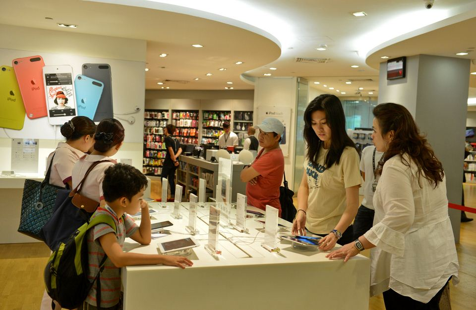 Customers browsing and trying out the Apple products on display at EpiCentre's Ion Orchard store.