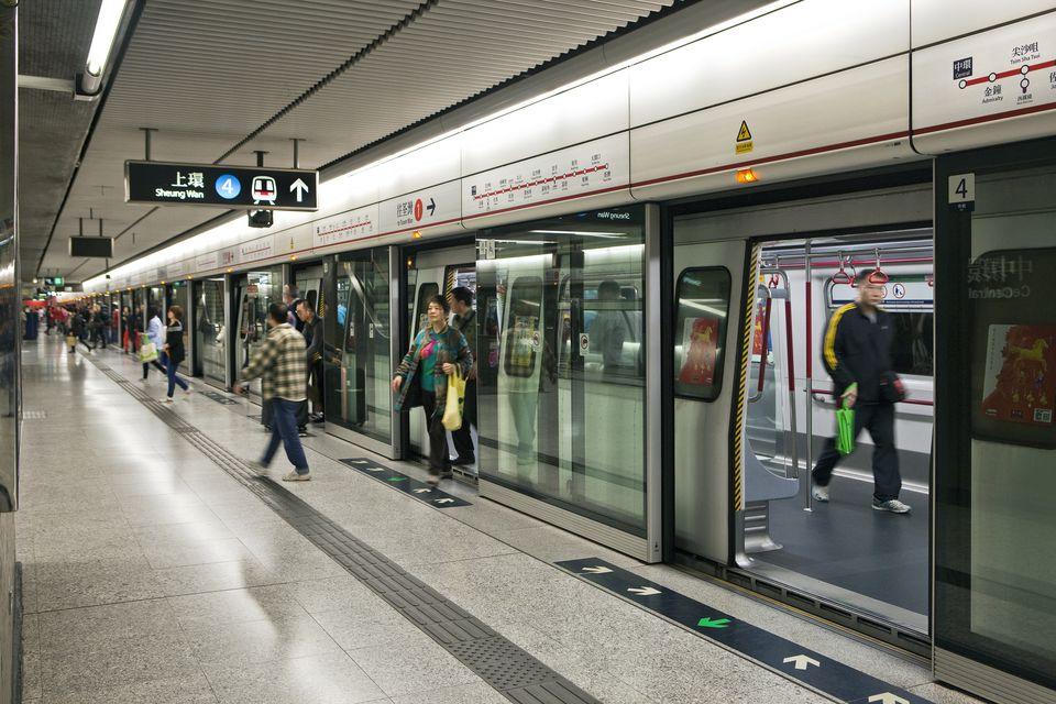 passengers-departing-at-mtr-subway hong kong