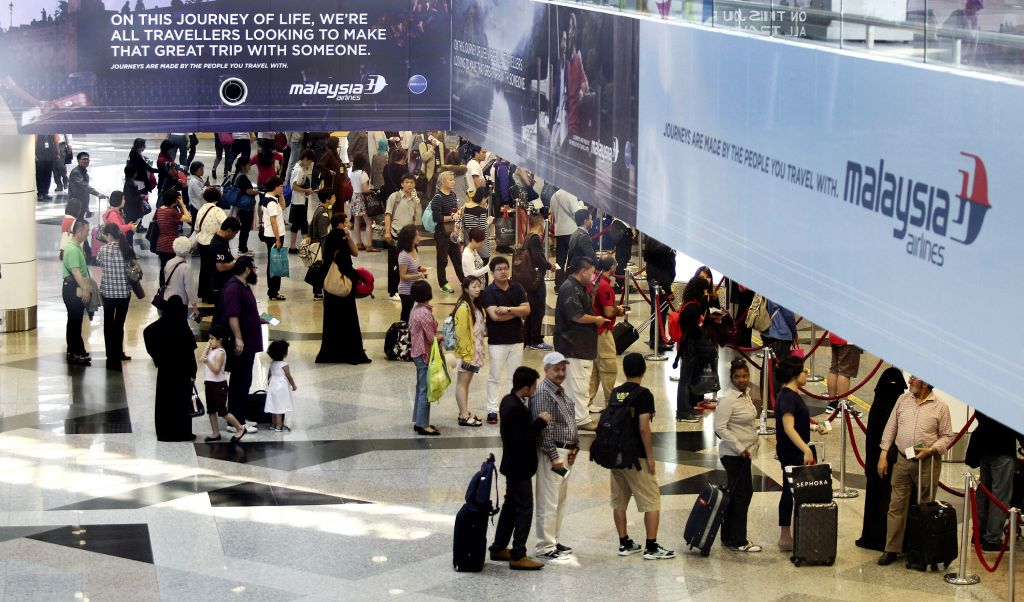 Passengers queue for customs checks at KLIA