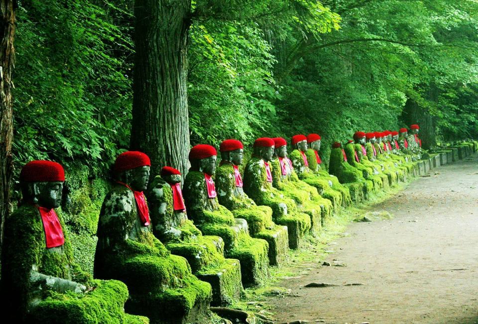 Narabi Jizo statues in Nikko forest by Kanmangafuchi gorge