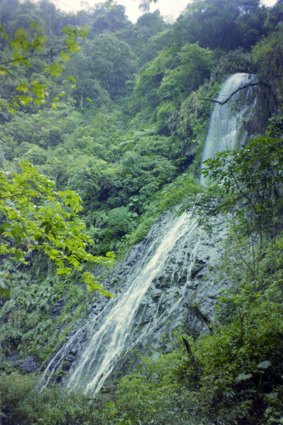 Lovely Qunyang ('spring sun') Waterfall lies in a gorge above Qunyang Hot