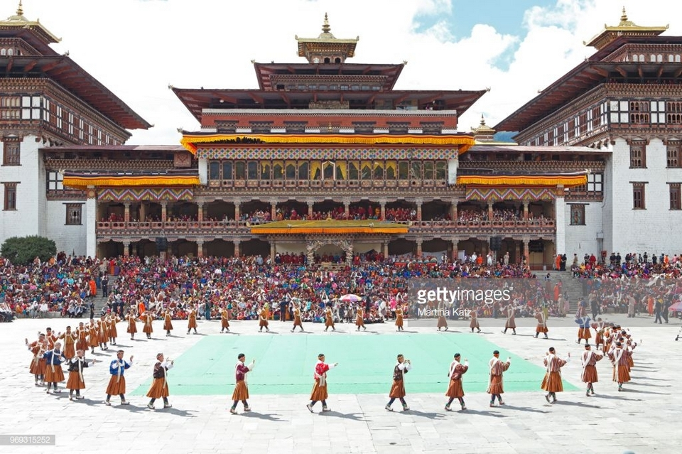 Dancers and spectators at the Tashichho Dzong monastery festival, Thimphu