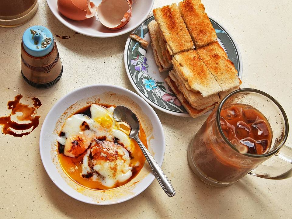 Kaya is a special cream served with toast and soft-boiled eggs, sip with a little of coffee is a standard meal.