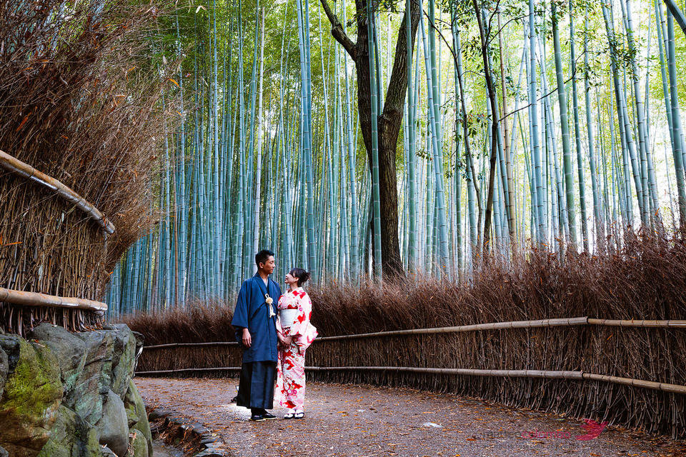 Couple in kimono at Arashiyama bamboo grove, Kyoto