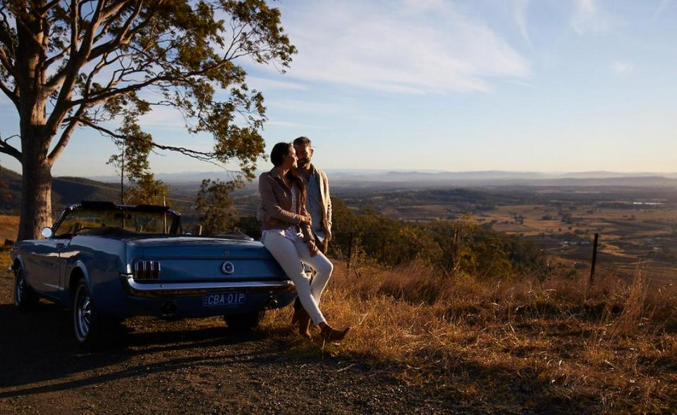 Couple pulled over to watch the sunrise in Pokolbin, Hunter Valley