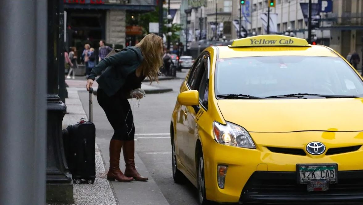 passenger-and-yellow-cab-taxi-in-vancouver