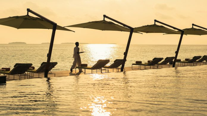 sunset at Anantara Kihavah Maldives Villas