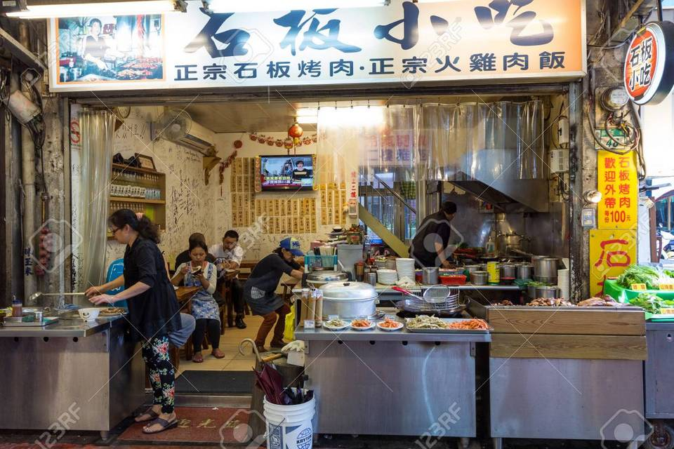 People eating at a small restaurant at the Wulai Old Street