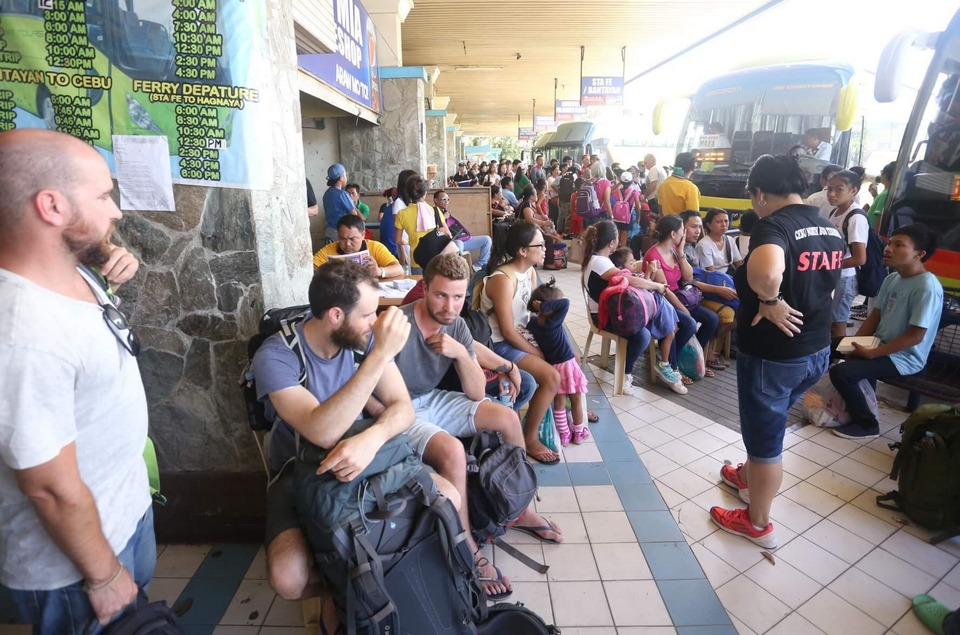 Tourists and locals wait for their bus rides at the North Bust Terminal