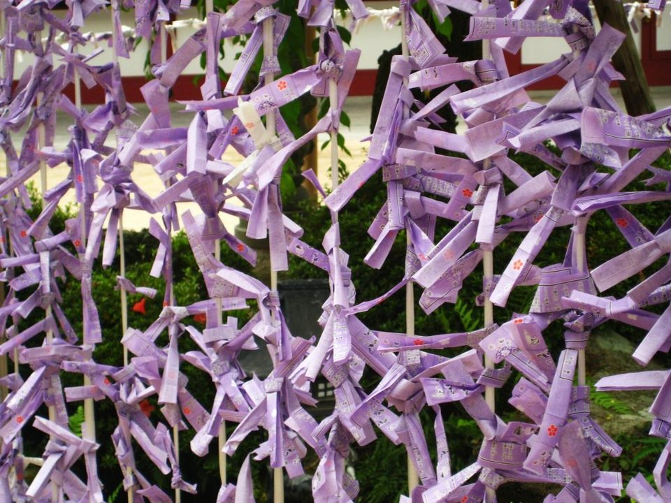 Folded prayer papers at Dazaifu Tenmangu Shrine.