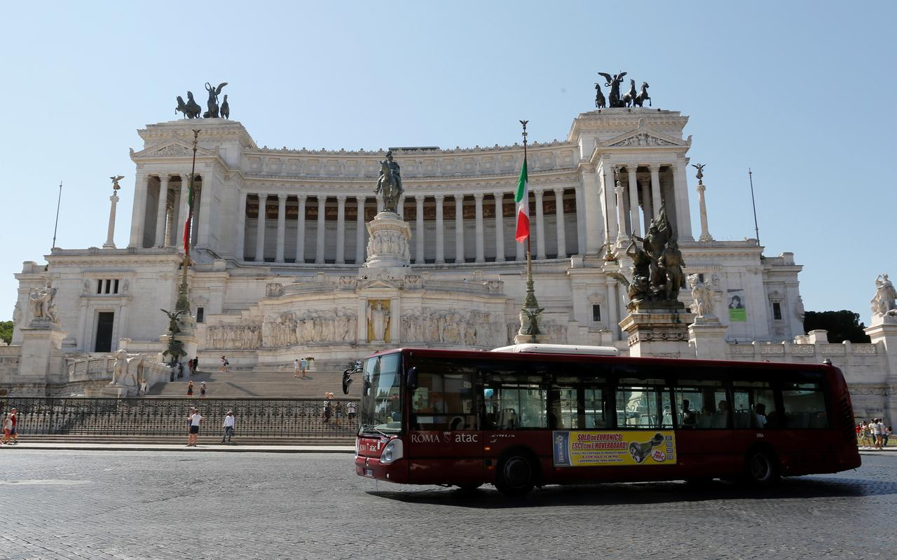 A public bus is seen in downtown Rome
