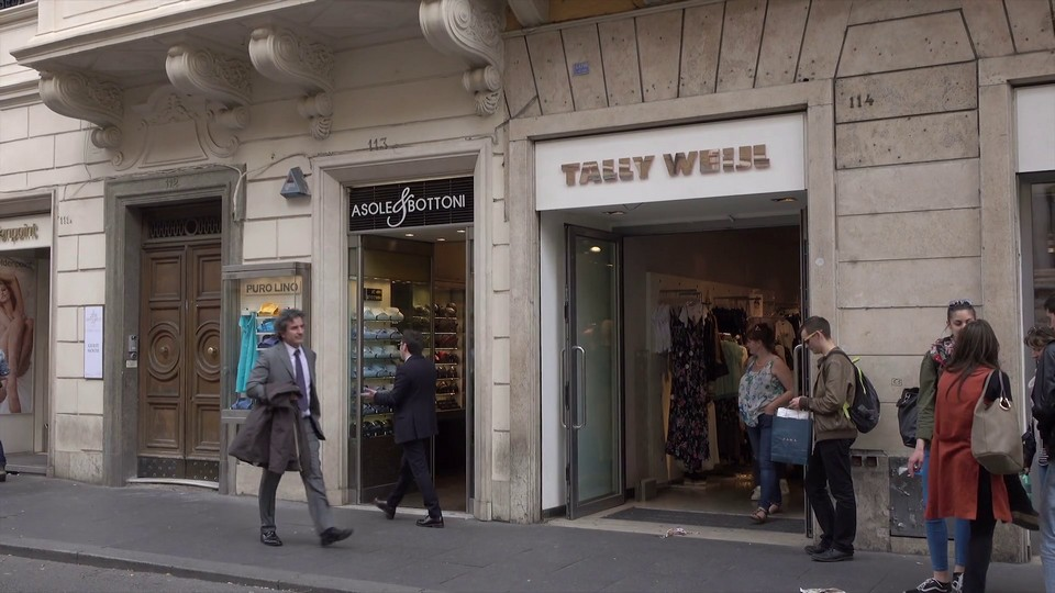 People walk and shop on Via del Corso shopping street, Rome, Italy, pan Stock Video Footage - Storyblocks Video