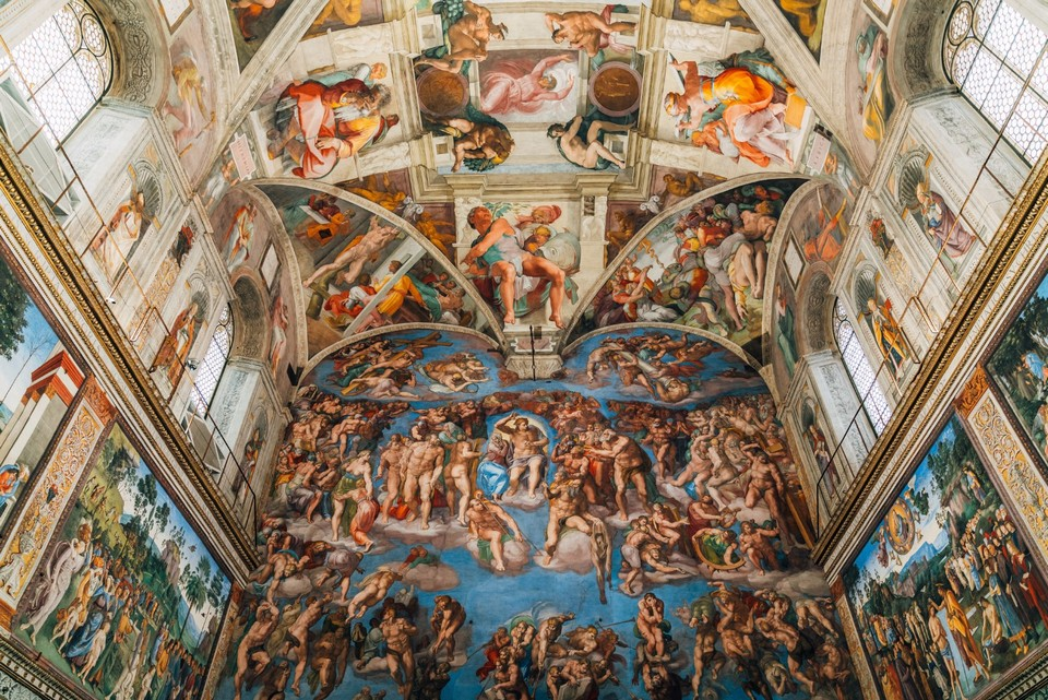 The artwork of Michelangelo on the ceiling of the Sistine Chapel