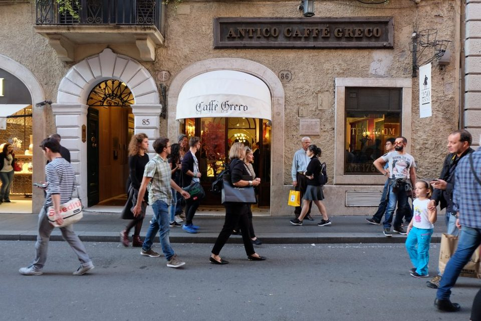 shoppers in rome walk by Antico Caffe Greco near the Spanish Steps