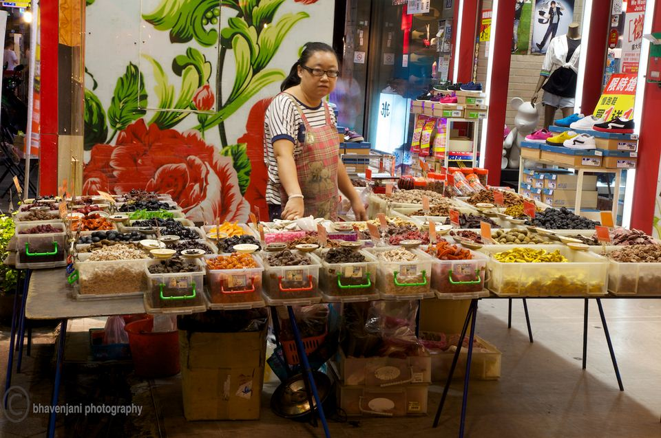 A lady sells spices at the Fengjia night market, Taichung, Taiwan