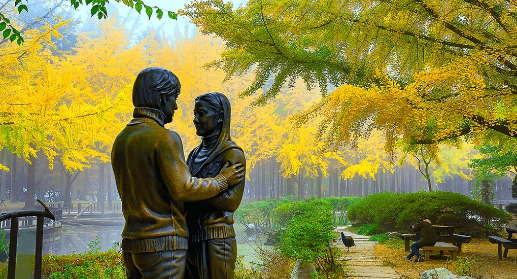 "Two famous statues of actor Bae Yong Joon and actress Choi Ji Woo in the movie ""Winter Sonata""."