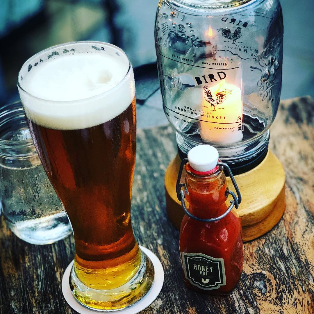 Enjoy a beer and watch the street at The Bird bar.