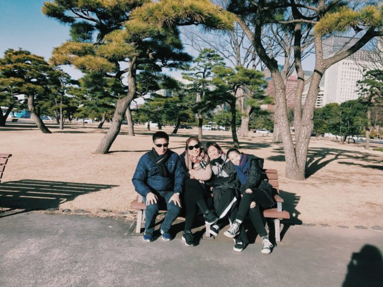 My whole family after a sightseeing tour, sunbathing at the park in front of the Imperial Palace
