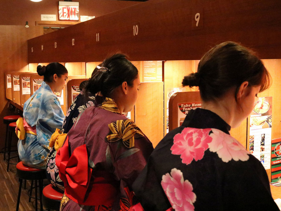 Tourist wear Kimono eating ramen