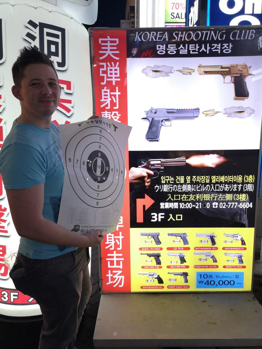 A man at myeongdong real gun shooting range
