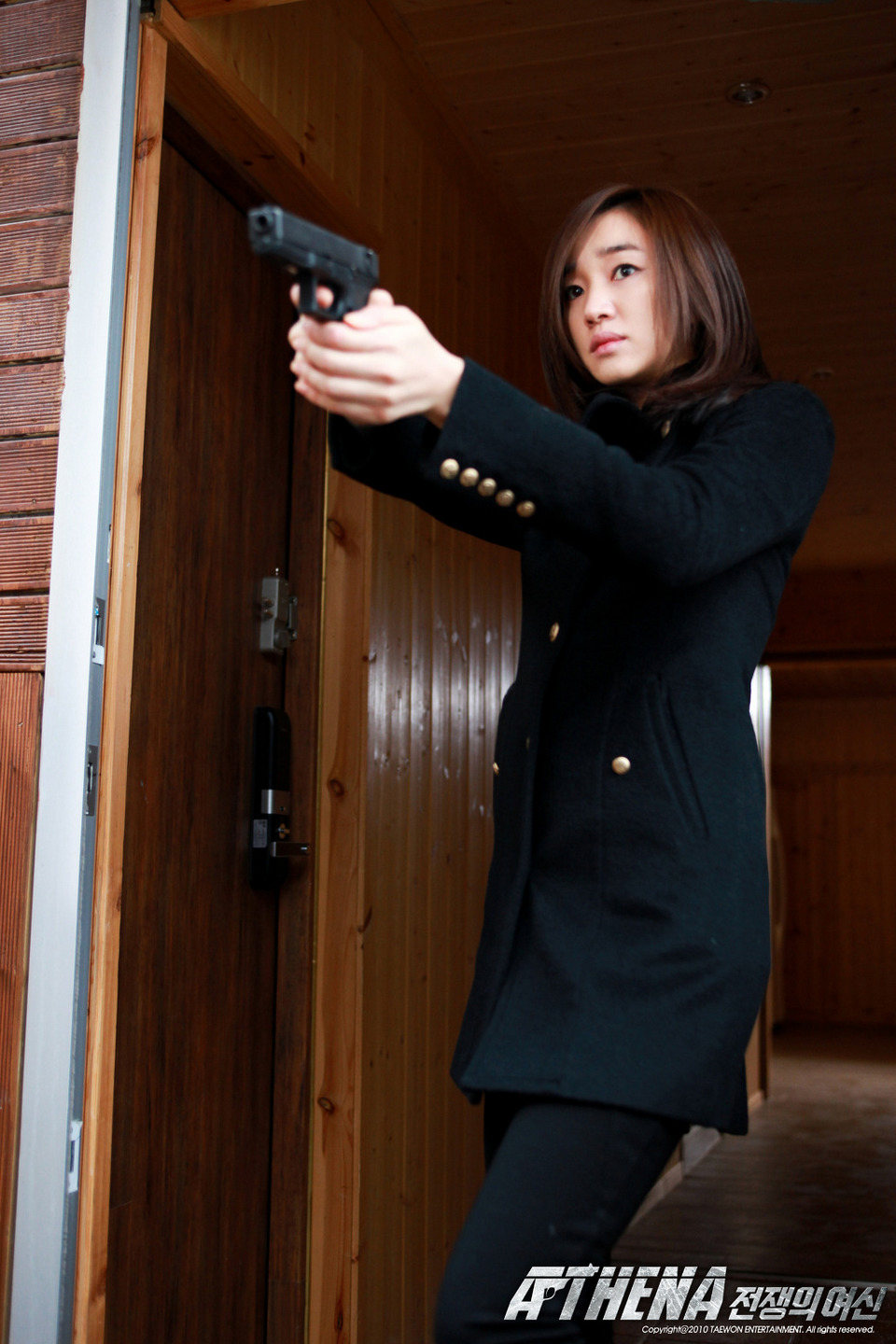 An actress with a gun in an action film
