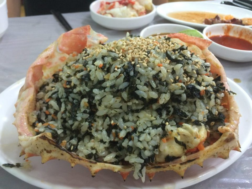 A close-up of rice mixed crab carapace