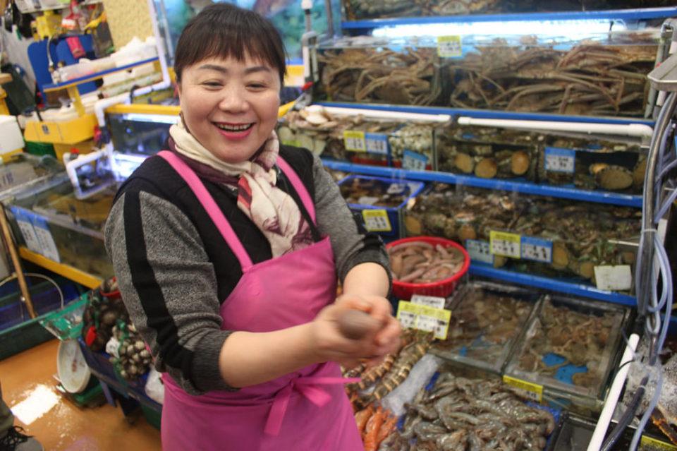 A pretty seafood stallholderr