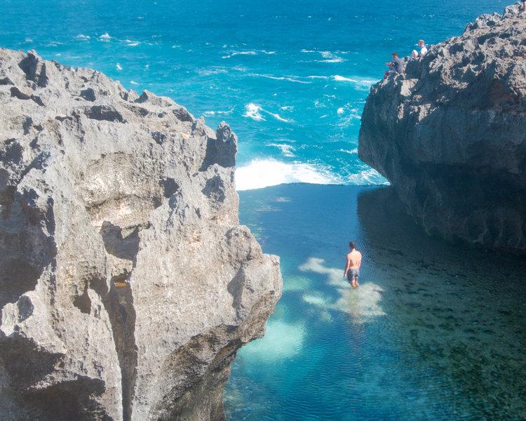 Angela Billabong Cliff with azure blue water